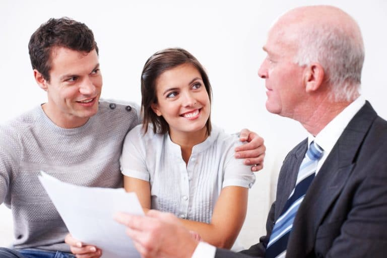 Young couple talking to a mortgage broker